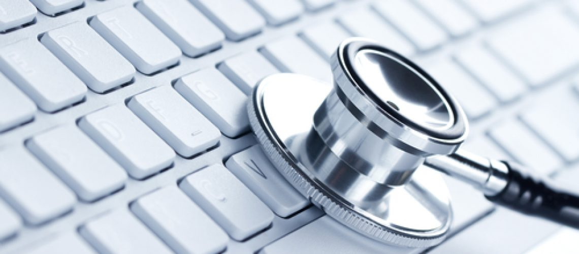 Silver,Stethoscope,Lying,Down,On,An,Laptop,,Toned,Blue