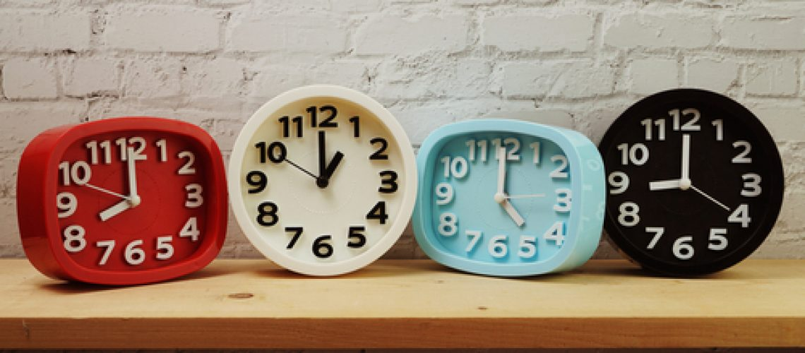 Clocks,With,Time,Zone,Of,Different,Country,On,Wooden,Shelves