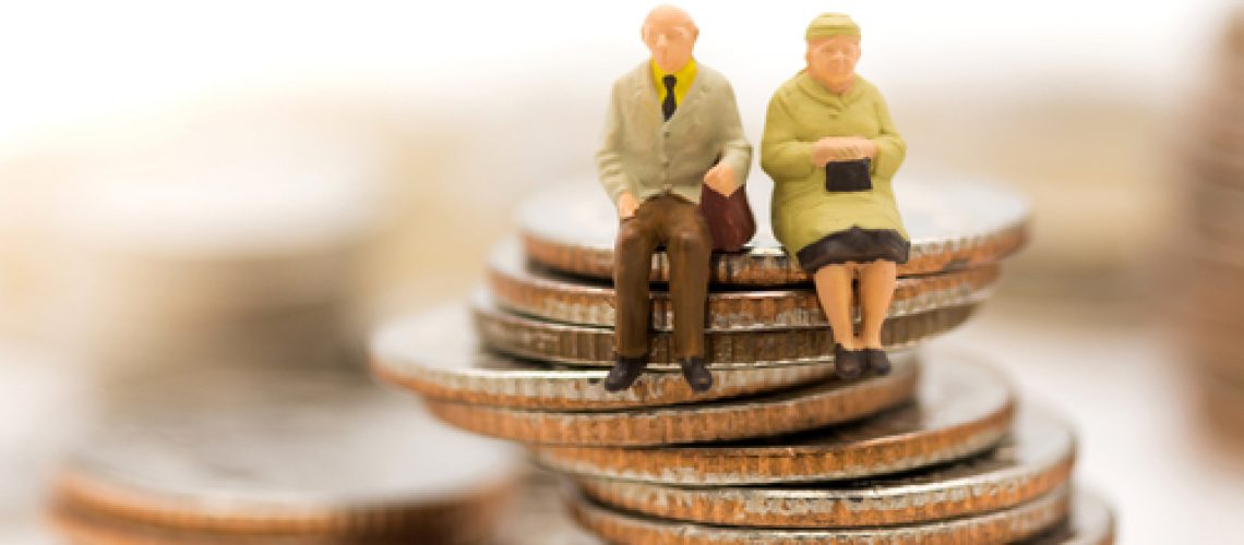 Miniature,People,,Old,Couple,Figure,Sitting,On,Top,Of,Stack